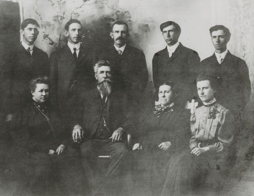 The Henry Brandenburg Bennett family: Vermont, Goldsby Alaska, Dakota, Arizona, Delaware. Seated: Nevada, Henry Brandenburg Bennett, Sarah (Milligan), Minnesota.