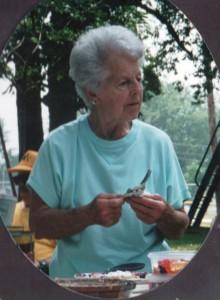 Aunt Em cutting her coconut cream pie. (2001 photo by Karen)