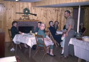 Christmas pot-luck dinner, c1962. L to R: Dorothy Humbert, Lucille Bransteter, Amber Oakley, Ercie Ripley, Vergie Buchanan, Rita & Bob Humbert, Ruth Broerien.