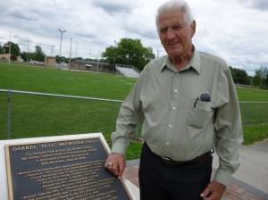 Darrel by his memorial plaque, East Jay Middle School football field. (2014 photo by Karen)