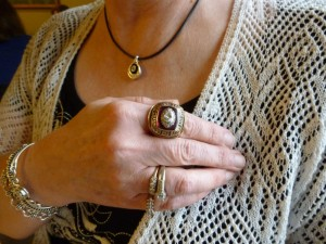Karen with Darrel's Super Bowl ring. (2014 photo by Karen)