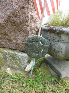 Flagstaff & flag at Edward J Kuehm grave. (2014 photo by Karen)