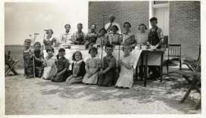 Getting ready to roast hotdogs, 1938 Schumm, with Rev. Moeller.