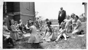 At Schumm Parochial School with Rev. Moeller. 1939.