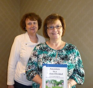"""Betsy Potts & Cindy Freed, with Cindy's book, """"Ancestors in a Nation Divided."""""""