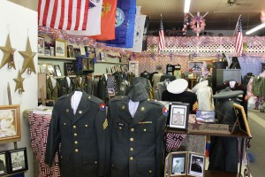 Uniforms, photos, and other items on display at Willshire Home Furnishings. (2015 photo by Karen)