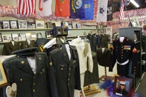 Vast array of uniforms, photos, and other items on display at Willshire Home Furnishings. (2015 photo by Karen)