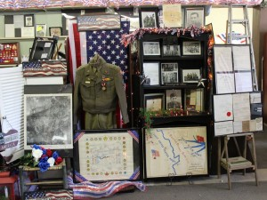 Display of Delmore Mitch [Aleta's father] WWII items, including maps. (2015 photo by Karen)