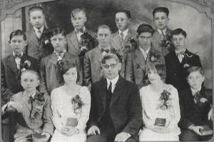 1929 Confirmation class at Zion Lutheran, Chattanooga. Seated: Morris Huffman, Bernice Becher, Rev. Albrecht, Pauline McGough, Waldo Brandt. Row 2: John Albrecht, Herb Brandt, Vernon Caffee, Elihu Davison, Werner Becher. Row 3: Reginald Fisher, Paul McGough, Charles Strabel, Luther Bollenbacher.