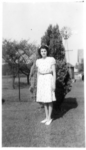 Florence Schumm with windmill and water tank in background. c1944.