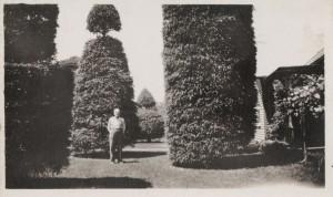 Louis J Schumm in their front yard.