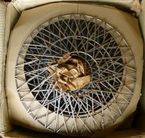 Box of wire wheel covers.
